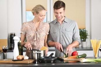 Woman and man cooking together