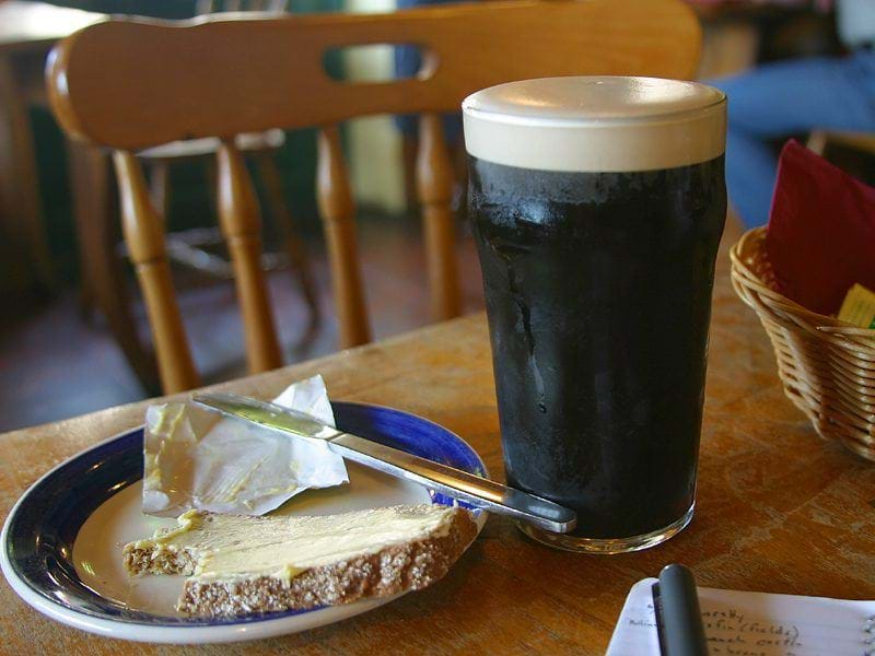 Pint of Guinness and a plate of buttered bread