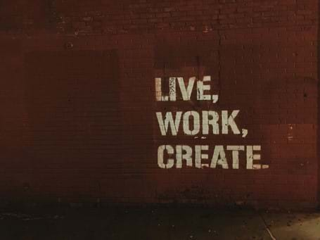 Live, work, create. saying painted on red wall