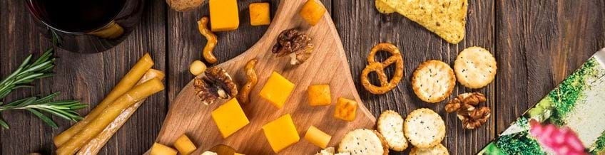 cheese board on a table with crackers round it